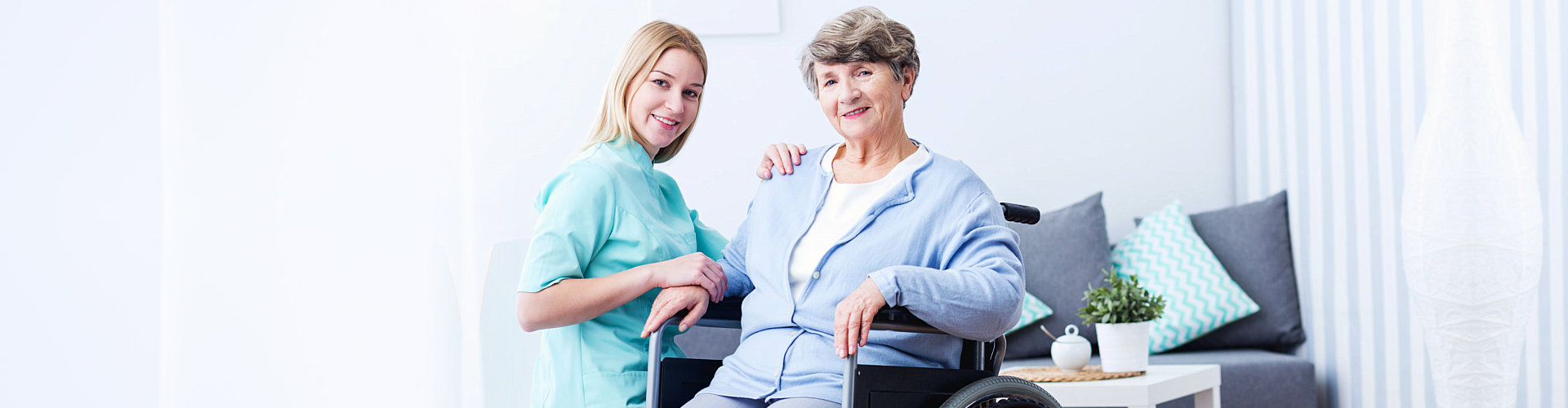senior woman on wheelchair with her caregiver